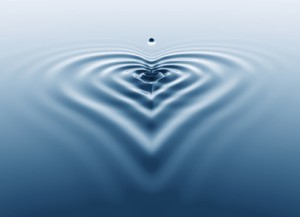 3d rendering of a water splash with ripple shaped as a heart.